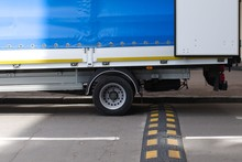 Truck Rear Wheels And Speed Bump On The Road