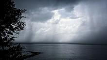 Cloudy Sky Over Sea On Rainy Day