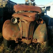 Old Rusty Car On Field