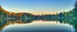 Panoramic View Of Trees Reflected On Water
