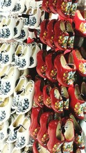 Close-up Of Clogs Arranged In ...