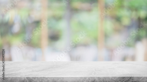 Fototapeta Empty white marble stone table top and blur glass window interior lobby and hall way banner mock up abstract background - can used for display or montage your products