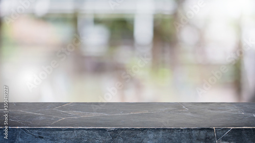 Fotografie, Obraz Empty black marble stone table top and blur glass window interior restaurant banner mock up abstract background - can used for display or montage your products