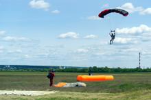 Kharkiv, Ukraine-May 26 2017: Parachutists Landing On The Ground Soft Air Pallet, Soft Landing