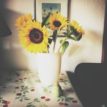 Sunflowers In Vase And Pear On...