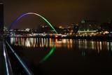 Illuminated Gateshead Millennium Bridge Over River Tyne Against Sky