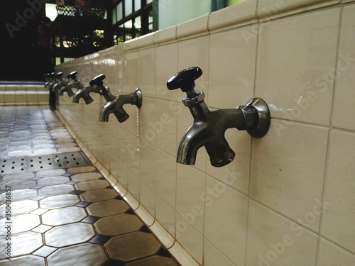 Photo Row Of Faucets For Traditional Muslim Ablution