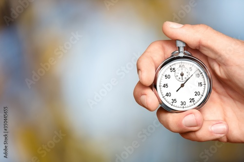 Silver classic stopwatch in the human hand Canvas Print