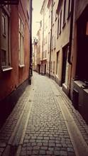 Cobbled Street Between Buildings
