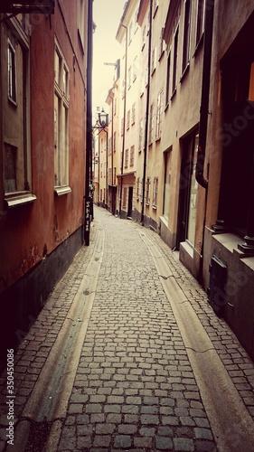 Valokuva Cobbled Street Between Buildings