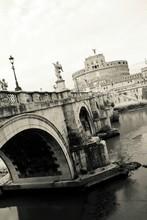 Tilt Image Of Castel Santangelo And Ponte Santangelo On Tiber River Against Sky