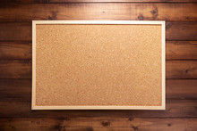 Cork Board On Wooden Background