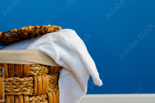 Pile of clothes in laundry basket indoors. Close up.