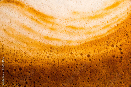 Fototapeta bubble Milk and coffee froth,Coffee in a glass,Milk and coffee close-up