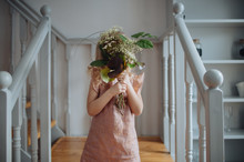 Young Girl Holding A Bunch Of Flowers