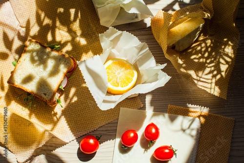 Fototapeta Plastic free kitchen concept. Beeswax wraps with food on them obraz