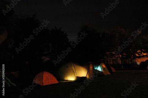 Canvas Print Illuminated Tents In Garden