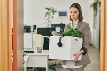 Sad Young Woman Carrying Box F...