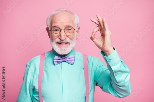 Obraz Portrait of positive cheerful old gentleman show okay sign decide choose perfect ads decisions choice wear good look outfit purple bow tie isolated over pastel color background - fototapety do salonu
