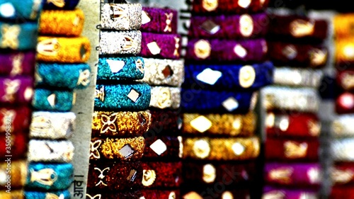 Tela Stacks Of Multi Colored Bracelets