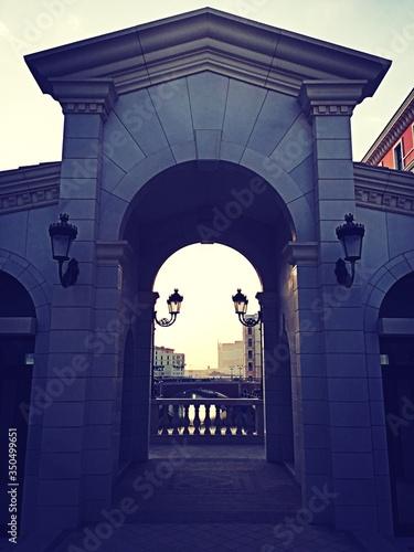 Lamps On Archway At Dusk Fototapeta
