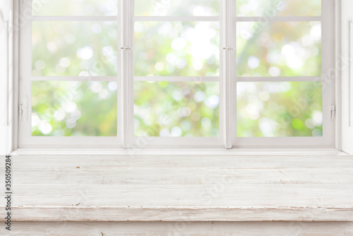 Fototapeta Vintage wooden table on blurred window background for product display obraz
