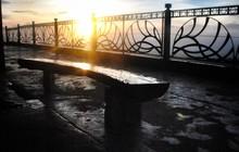 Sun Gleaming Through Iron Rail...
