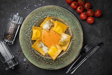 Yellow Ravioli With Cheese In ...