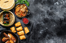 Chinese Food. Noodles, Dumplings, Stir Fry Chicken, Dim Sum, Spring Rolls. Chinese Cuisine Set.  Black Background. Top View. Copy Space