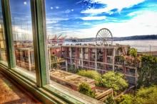 Buildings And Ferris Wheel See...