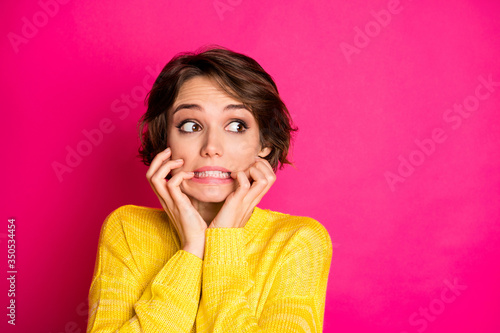 Obraz Portrait of frustrated anxious afraid girl look copyspace see she made horrible mistake bite finger nails wear sweater isolated over bright color background - fototapety do salonu