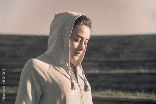 Portrait of hooded girl with downcast gaze Canvas Print