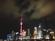 Low Angle View Of Illuminated Oriental Pearl Tower And Cityscape Against Sky
