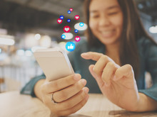 Social Network Sharing And Commenting In The Online Community. Woman Hand Holding Smartphone And Using Application Social Media