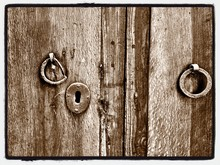 Close-up View Of Door Knocker And Keyhole
