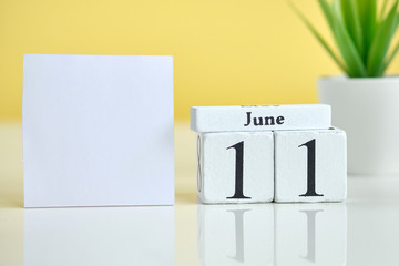 11 eleventh day june Month Calendar Concept on Wooden Blocks. Copy space.