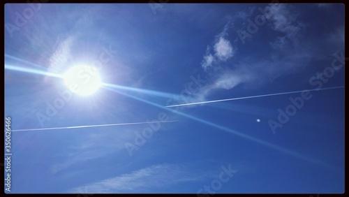 Fototapeta Low Angle View Of Bright Sun In Blue Sky obraz na płótnie