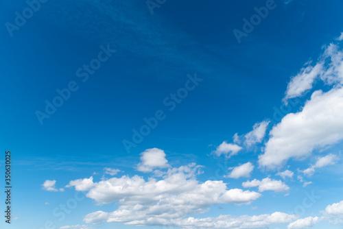 Obraz na plátně Beautiful blue sky and close-up white clouds.  Nature background.