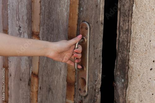 Fototapeta woman and wooden door in garden obraz na płótnie