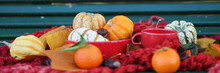 Cozy Autumn Still Life. Composition With Red Mug Of Coffee, Pumpkins, Chestnuts, Clementines And Red Scarf. Banner