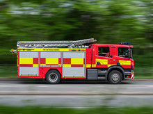 Fire Engine Driving Along Road