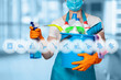 Cleaning lady with cleaning products on blurry background .