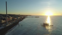 Brighton West Pier, British Airways I360 Viewing Tower And Brighton Palace Pier At Sunrise With Calm Sea