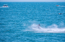 The Jet Ski Swims Quickly Across The Sea, Picking Up Many Waves And Splashes.
