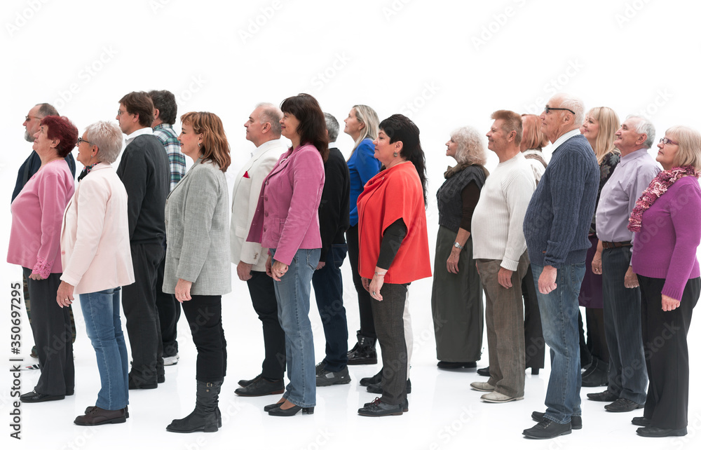 Fototapeta Profile view of a group of people isolated over a white background