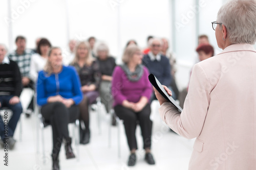 Businesswoman addressing colleagues at office meeting