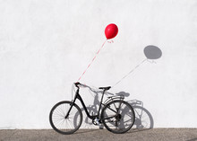 Lonely Bike With A Balloon Att...