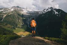Man Hiker Standing On A Hillto...