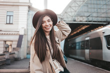 Smiling Girl In Hat At Train S...