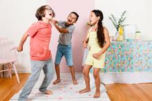 Siblings Dancing Confetti At H...